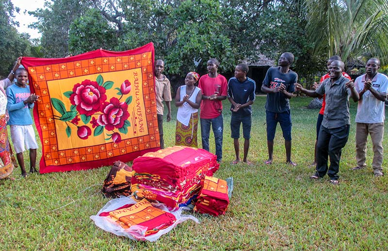 Distributing blankets for five-day evangelism outreach